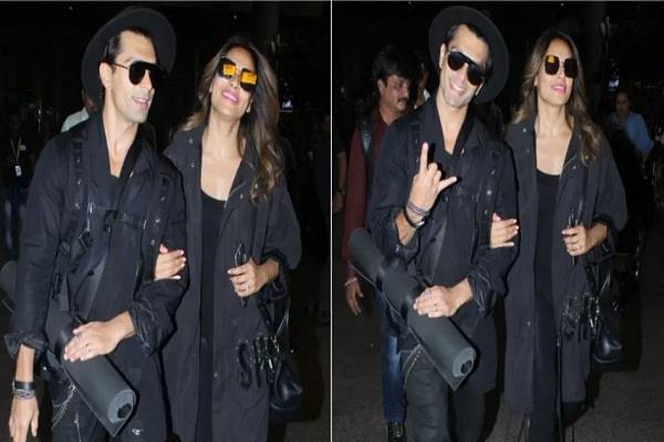 bipasha basu spotted at airport with husband