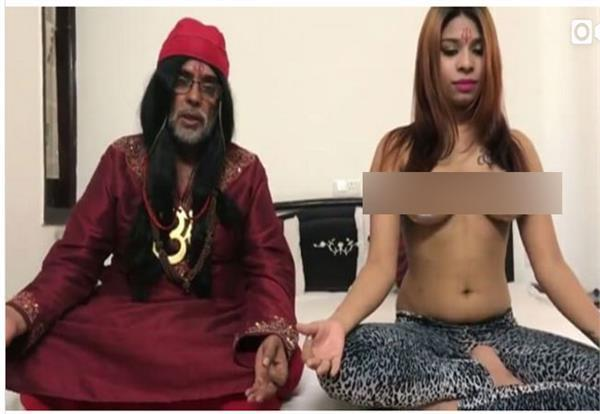 swami om giving yoga lessons to a topless girl