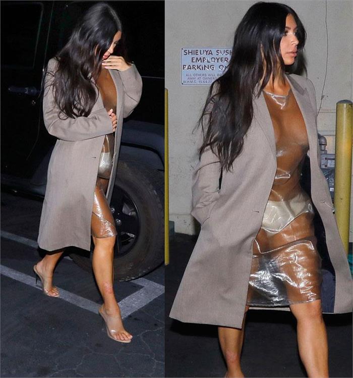 kim kardashian shows bare breast dress