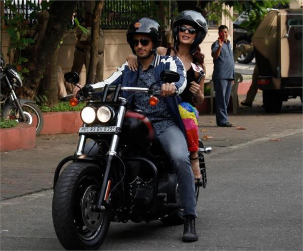 sidharth malhotra jacqueline snapped on the bike for a gentleman promotions
