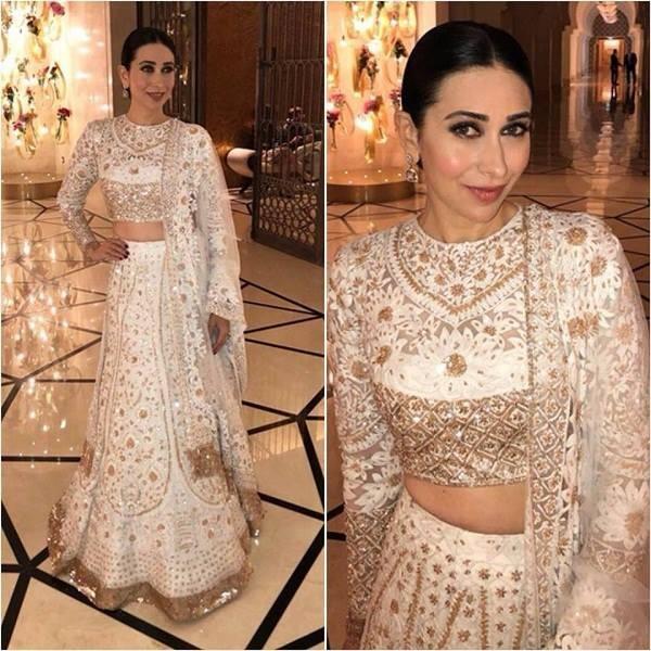 karishma look gorgeous in white and gold lehenga
