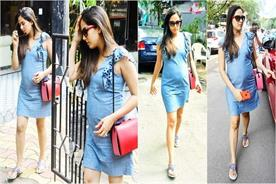 mira rajput flaunts her baby bump in a denim dress