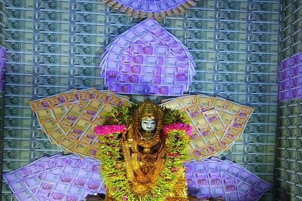 mother of ambigui decorated with notes in tamil nadu tamils celebrated new year