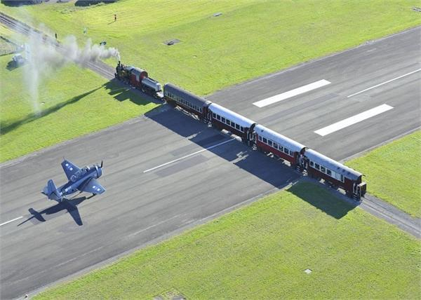 weird airport there cross plane and train together