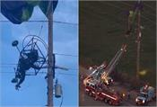 person caught in lightning cables due to paraglider crash  down with crane