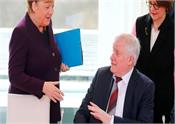 german minister for chancellor angela refuses to shake hands