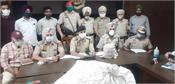 2 smugglers arrested with 263 grams of heroin  ammunition and 60 000 pills