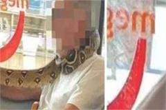 coronavirus england person mouth snake face mask