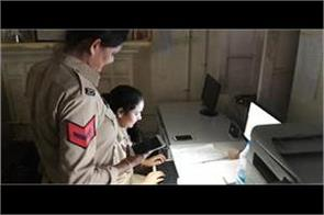 ladies police work with mobile torch in police station