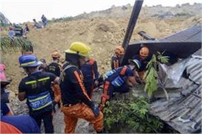 landslide kills 18  buries houses in philippines