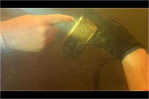 iphone fell in water youtuber finds it 15 months later and it still works