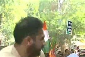 rafale congress bjp protest rahul gandhi poster