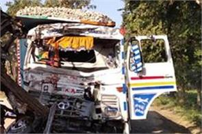 one dies in a collision with 2 trucks