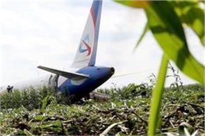 private jet crash lands on cornfield
