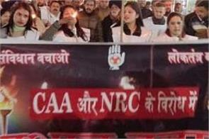 youth congress torch procession protest against nrc caa