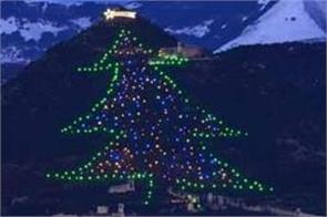 the world  s largest christmas tree with 2300 lights built on a mountain in italy