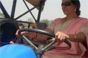 bjp mp hema malini drives tractor