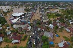 floods in indonesia  10 dead and thousands homeless