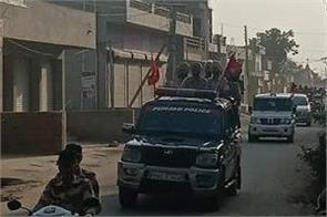 police flag march to keep peace after killing dera premi
