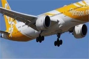 13 year old boy allegedly behind bomb hoax on scoot flight