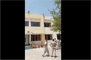 women on the roof of tehsil complex to provide justice to widow sister