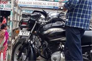 12 motorcycles parked illegally and two cars seized