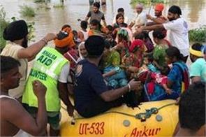 khalsa aid  flood victims  help