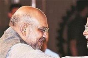 desh seva narendra modi 20 years amit shah congratulations