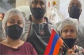 armenia  azerbaijan punjabi family serving food