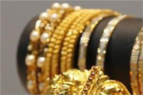 gold prices dip marginally