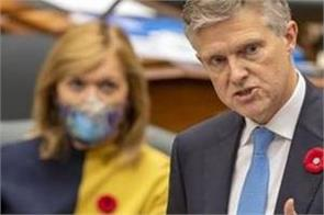 ontario finance minister out of country vacation  covid19
