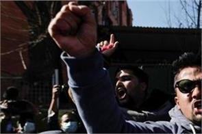 hundreds protest against nepali pm s