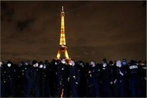french police hold small but bold protest near eiffel tower