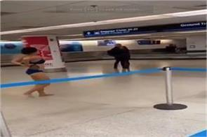 women naked at miami airport  riot on internet