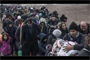 over 400 syrian refugees return home