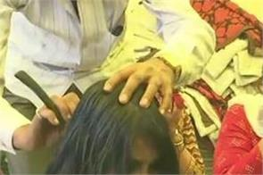 madhya pradesh women teacher hair rahul gandhi