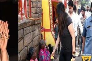ekta kapoor gets trolled for   throwing   bananas at beggars outside temple
