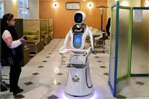multilingual robot waitress serves up fries in afghan capital