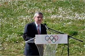 who advises on olympic cancellation ioc  bach
