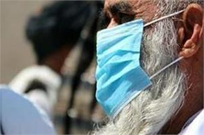 dangerous terrorists also kneel before corona  distributing masks to people