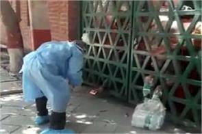 water and biscuits tossed from outside shut gates of agra quarantine centre