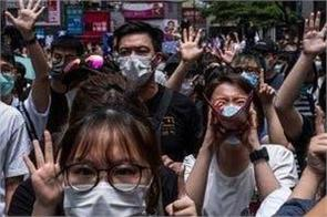 hong kong people take to the streets again  protesting against chinese law