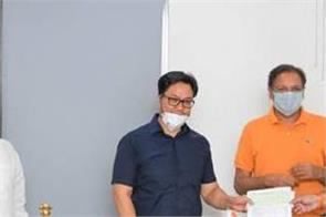 ioa hands over rs 2 crore to sports minister kiren rijiju fight covid 19