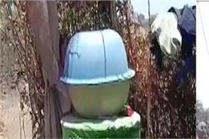 mp  residents jhabua dist store water in drums   locked