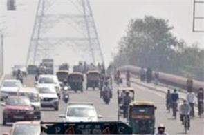 new delhi vehicles are seen on the road