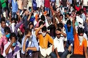 hundreds of workers chanted slogans against management