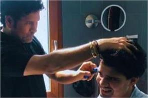 tendulkar cut his son  s hair  said  father has to do everything