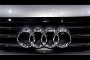 audi expects sales to improve next year