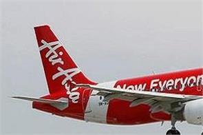 air asia cuts pilots salaries by 40 percent