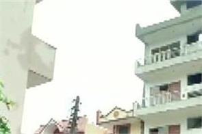 haryana gurugram rain building bent police